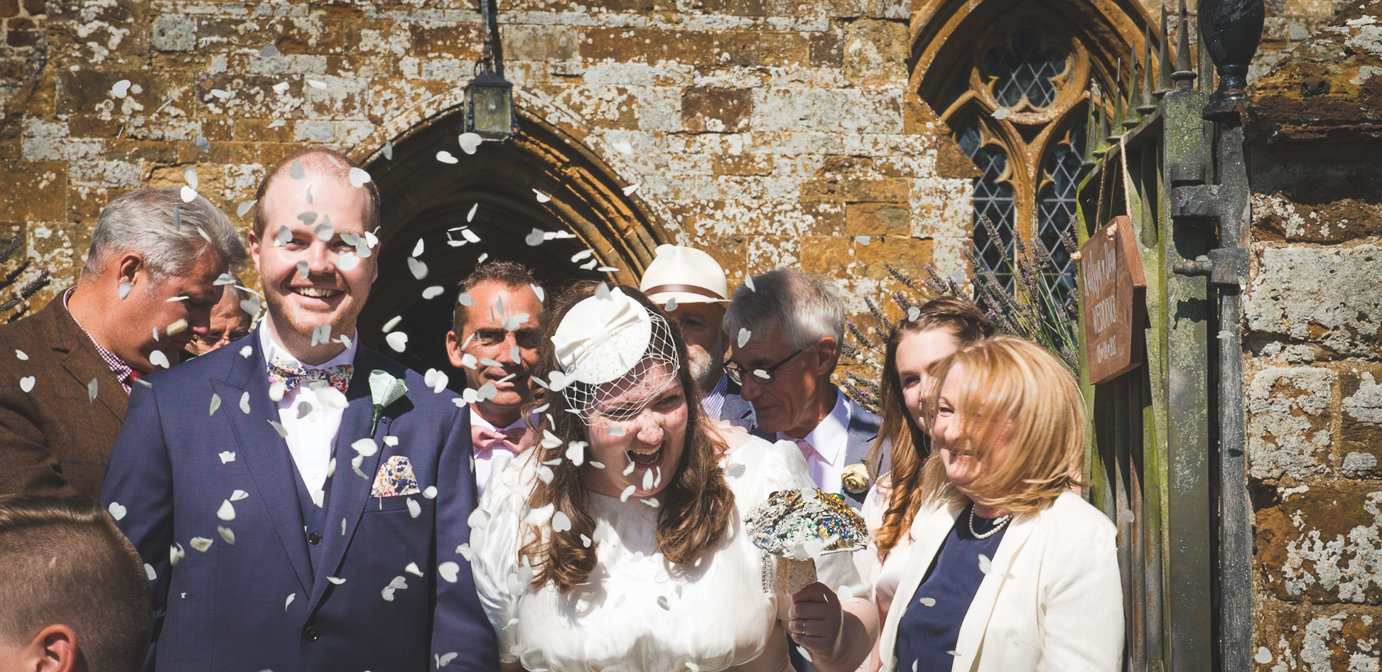 Bride and groom, confetti, culworth church, oxfordshire weddings, happy, love brooch bouquet