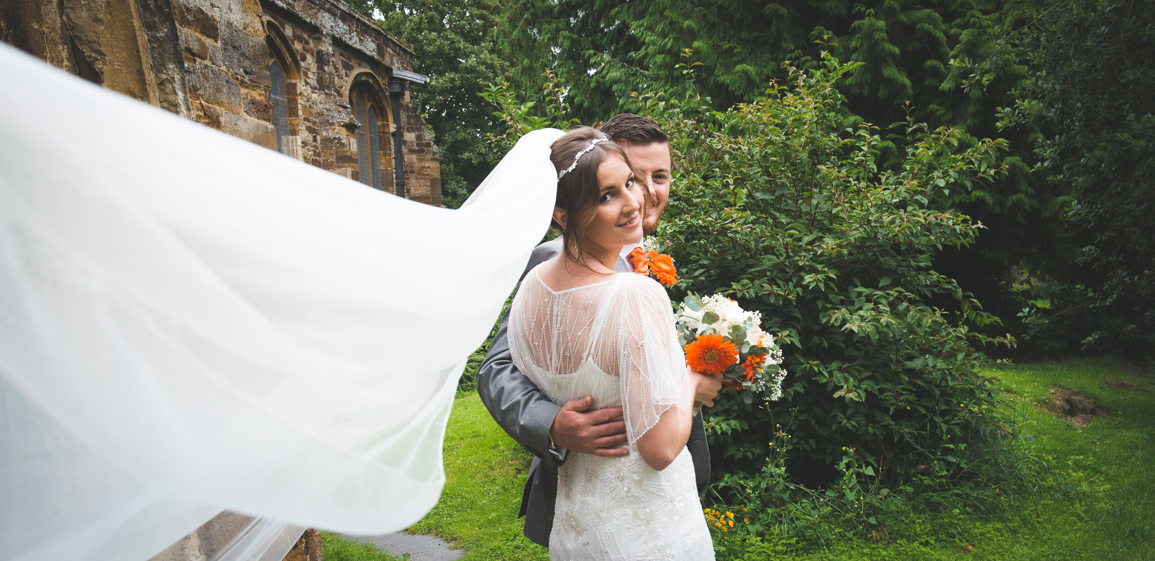 Long veil on a windy day, orange and grey theme, windy wedding, rainy day wedding