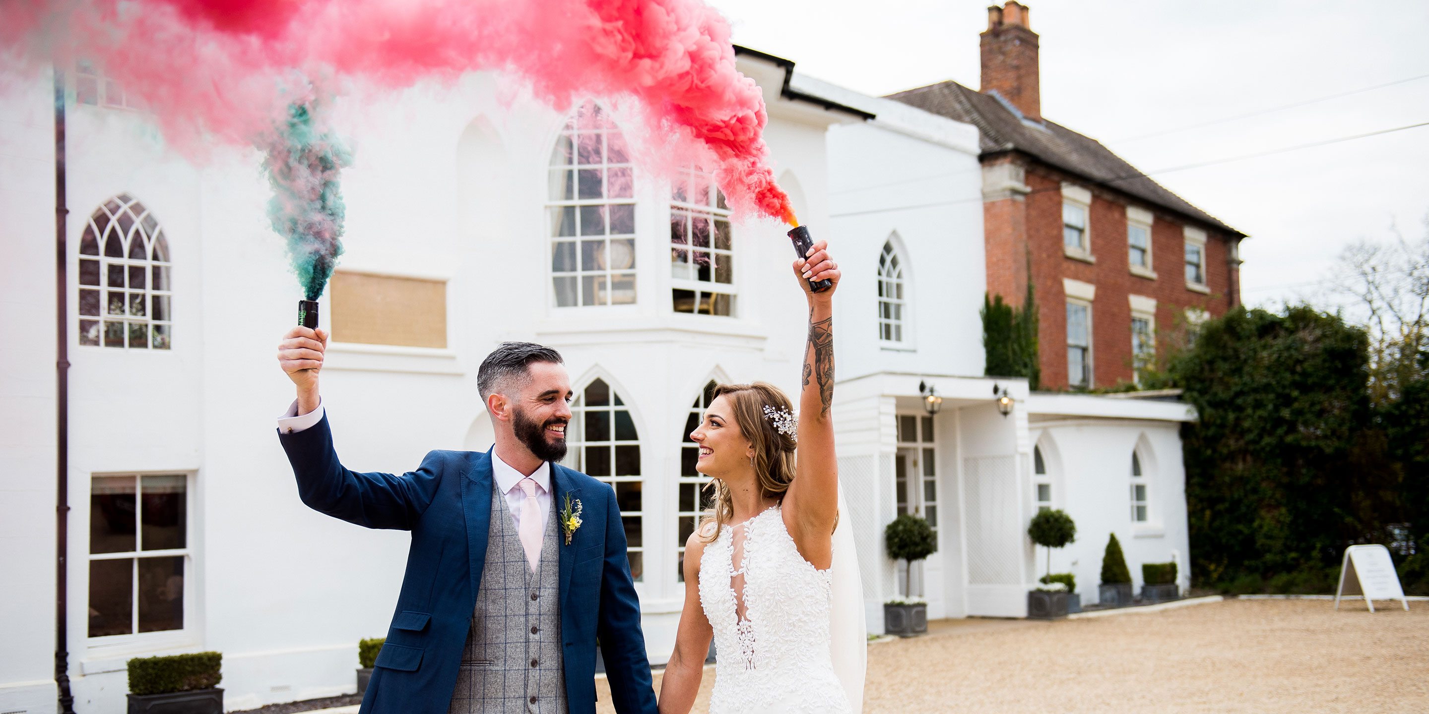 Colourful flares at Warwick House weddings , warwickshire wedding photographer