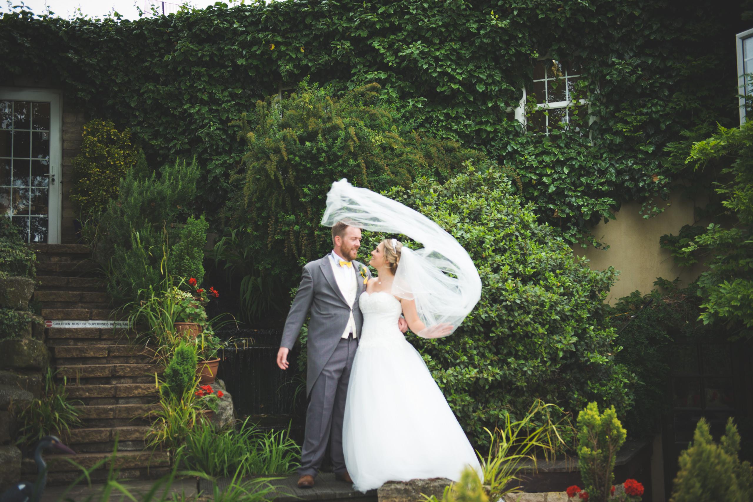 windy wedding, veil not playing ball, veil, wedding photography, wedding photographer, bride and groom, whittlebury hall wedding, wedding photographer northamptonshire